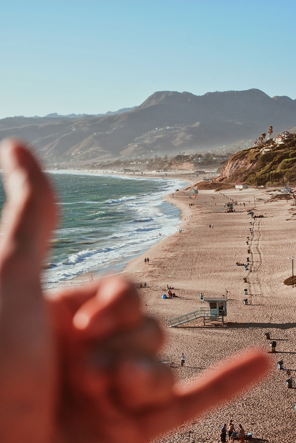 Blog Johannes Article Work Away From Home man throwing schaka with beach in the background.